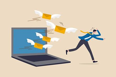 Email overload and businessman running away from emails | Theia Marketing